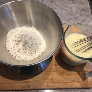 Seasoned flour and eggs whisked into milk